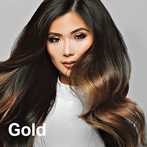 hair model showing off gold kit